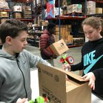 Harrisburg Christian School students packing boxes at the food bank