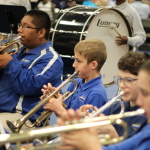 Boys playing instruments in band performance