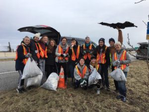 WSCA high school students smiling during NHS highway cleanup project