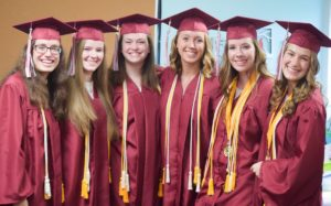 Group of WSCA Recent Graduates in cap and gown attire